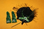 "This second pair of shoes matches the hatband of Darq's ""Evenora Green Dress."""