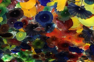Glass flowers, some with 3 ft. diameters, hang from the ceiling of the Bellagio, Las Vegas NV - @ 2013 www.CatherineEmclean.com