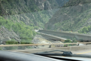 Taken from inside the truck's cab: Cantilevered, 2 deck Interstate, Colorado river (L), miles and miles of winding roads going downhill toward Utah.